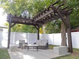 backyard with white fences and l shaped corner pergola corner