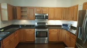 resurface kitchen cabinets ta bay cabinet painting refinishing kitchen cabinets wood