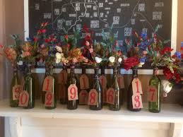 wine bottle centerpieces 7 1 17 wine bottle centerpieces table numbers coming together