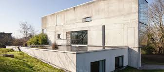 textured front facade modern box home concrete homes curbed