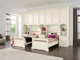 bedroom furniture tall white wooden cupboard with twin bed on