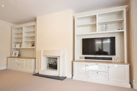 double white wooden shelves with stoarge and black led tv also