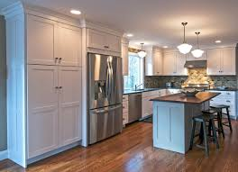 how to make cabinets appear taller how to get a custom look kitchen using stock cabinets