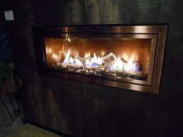 brand new linear gas fireplace from mendota with copper panoramic