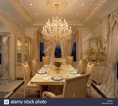 spanish dining room furniture ornate glass chandelier above table set for dinner in opulent