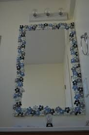 glass gems with pearl marble centers to dress up a bathroom mirror