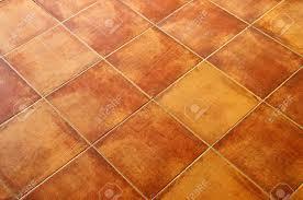 closeup of square terracotta ceramic tile floor background stock