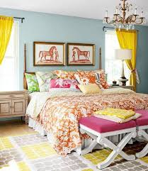 guest bedroom decor with colorfull bedding and benches and carpet