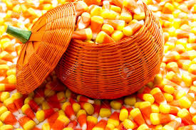 pumpkin candy corn orange pumpkin wicker basket fill with candy corn stock photo