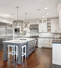 red oak wood classic blue shaker door grey and white kitchen red oak wood classic blue shaker door grey and white kitchen cabinets backsplash subway tile porcelain ceramic tile countertops sink faucet island lighting
