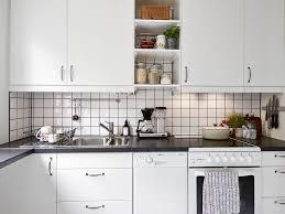 kitchen subway tile definition sleek stainless steel microwave wooden laminated flooring stone walls texture backsplash