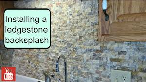 How To Install A Tile Backsplash In Kitchen by Installing A Ledgestone Backsplash Youtube