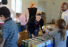feed the homeless on thanksgiving volunteers help mission solano pack for food giveaway