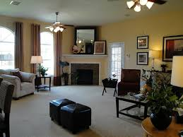 arrange furniture in living room with corner fireplace and