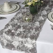 tablescape rosette table runners in silver yellow napkins