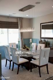 Dining Room Hanging Lights Chairs At Dining Table With Hanging Lights Stock Photo Getty Images