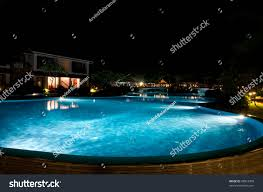 pretty swimming pool night local resort stock photo 48973390
