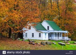 charming house with colorful trees in the indian summer vermont