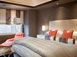 bright orange ribbon shaped pillow dark gray wallpaint bright