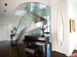 grandiose circular chrome polished handle stairs with clear glass