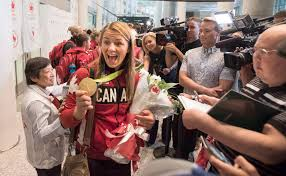 Canada Flag Bearer Olympic Athletes Return Home To Cheering Fans And Relatives
