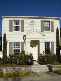 photos hgtv white colonial home with sage green shutters haammss