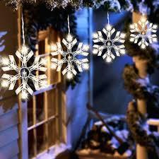 outdoor hanging snowflake lights outdoor christmas lights snowflakes chritsmas decor
