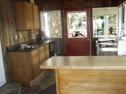 designs for kitchen islands with tradidional wooden table and