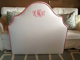 twin size notched upholstered headboard white linen pink cording