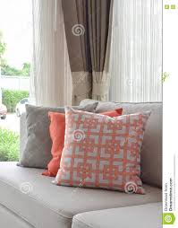 Orange Pillows For Sofa by Graphic Pattern Orange And Gray Pillow On Beige Sofa Stock Photo