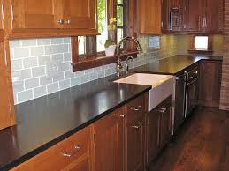 kitchen style subway tile backsplash and medium brown cabinets
