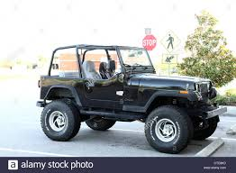 black jeep old black cj jeep with big wheels stock photo royalty free image