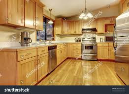 kitchen golden wood cabinets hardwood floor stock photo 95951332