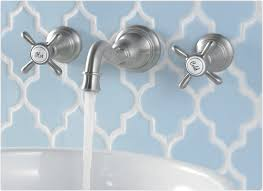 moroccan themed bathroom with blue tiled backsplash featuring wall