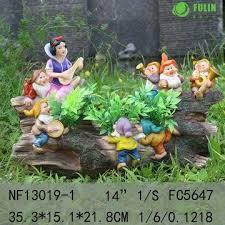 china resin snow white and seven garden solar light on