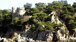 medieval old castle seashore cliff man trees sea walkway shore
