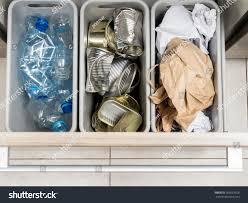 three plastic trash bins kitchen cabinet stock photo 263033528