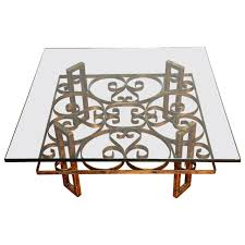 gilded wrought iron square coffee table with scroll motif glass