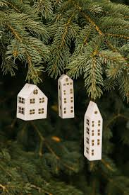 house ornaments in white and gold