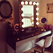 bathroom black wooden vanity table with mirror and light aded