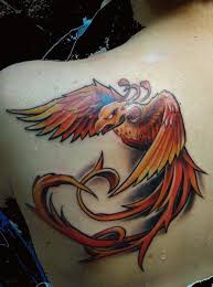 a powerful tattoo design of a phoenix bird in an agressive flying