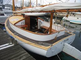 varnishing a wooden boat with organic linseed oil marine varnish