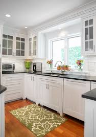 coastal white kitchen with custom beadboard cabinetry the good