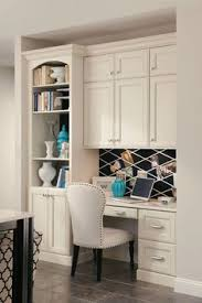 office kitchen furniture home office with a built in desk and counters which provide a lot