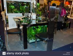 paris france glass aquarium dining table on display in consumer