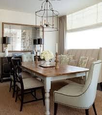 sleek black metal chandelier and rustic white table for english