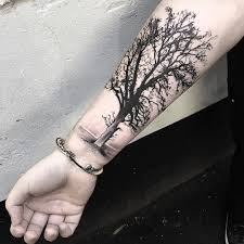 black and grey tree tattoo on right forearm jpg 1080 1080 body