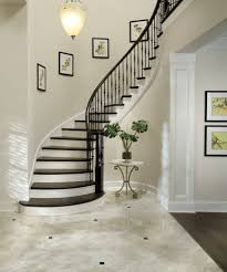 hall and staircase staircase traditional with open tread curved