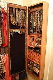 Ikea Wall Mount Jewelry Armoire Lots Of Jewelry And Necklace Storage Concealed In A Wall Mounted