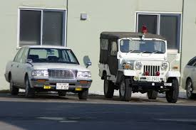 mitsubishi military jeep file mitsubishi jeep u0026 toyota crown jpg wikimedia commons